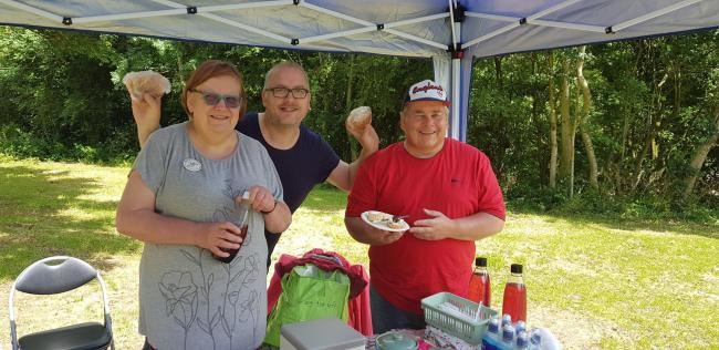Fun in the sun: Volunteer Maureen Rowley with councillors Joe Baker and Bill Hartnett