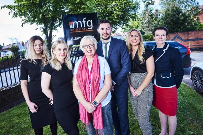 Elaine Scrafton from Worcestershire Breast Unit Haven with some of the staff from mfg Solicitors