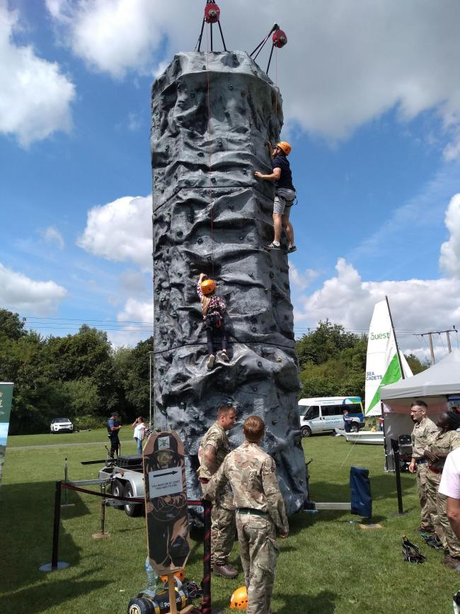 The army climbing wall was a popular attraction on the day. Photo by Brian Rich.