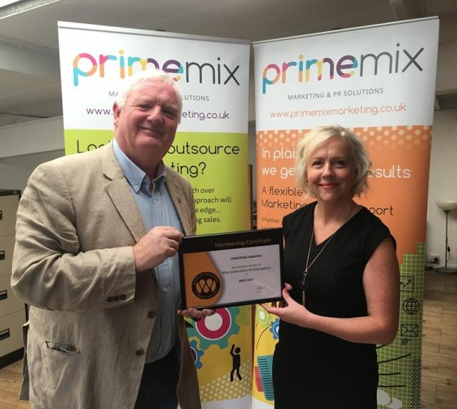 CELEBRATION: Christina Darling with Worcestershire Ambassador Chair Kevin Powell at the Prime Mix office in Worcester.