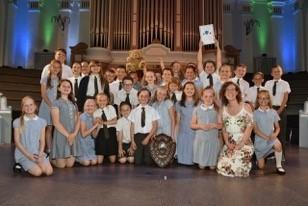 St Oswald's pupils and Music Teacher Shula Barnes-Smith receiving the Shirley Holland memorial Shield. PIC: Colin Hill