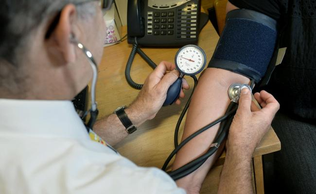 File photo dated 10/09/14 of a GP checking a patient's blood pressure. Stroke survivors living with a disability will rise by a third by 2035, doctors have said as they warned the UK needs far more specialists in stroke medicine. PRESS ASSOCIATION Pho