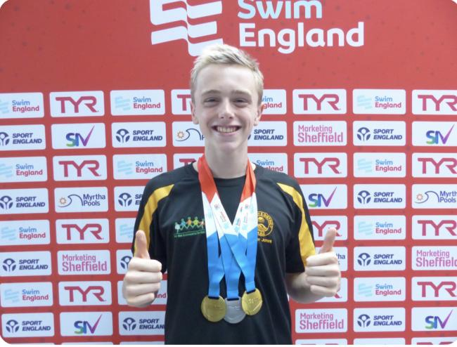 Six PBs for swimmer Ollie at national championships