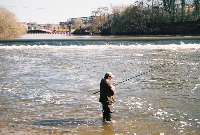 A fisherman casts his line at Diglis Weir, Worcester. Picture by John Phillpott.