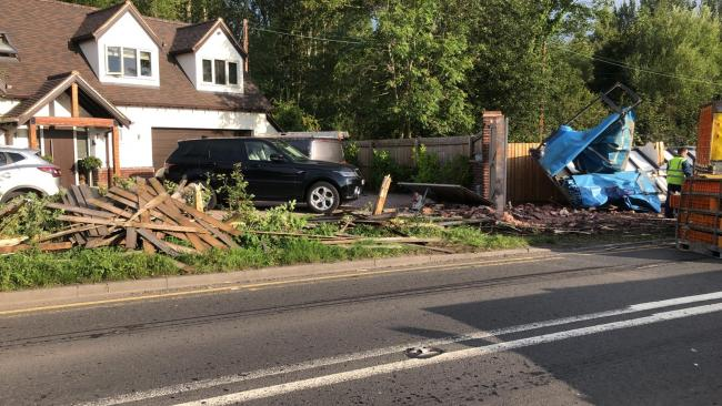 SCENE: The lorry smashed into the family's wall and fence after coming off the bridge