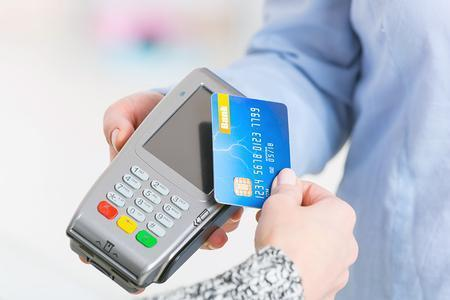 A contactless card payment. Stock image