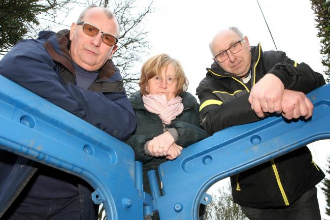 Kingsland residents, from left Mark Graham, Caroline Williams and John Nicholls look down at the sinkhole which has closed Lugg Green Road..