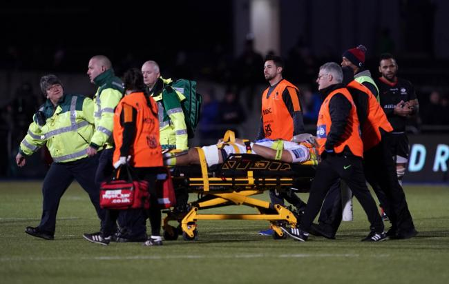 INJURY: Michael Fatialofa being stretchered off after his neck injury against Saracens. Pic. Tess Derry. PA
