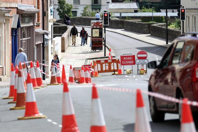 Signs and bollards on Bridge Street have been put in place by the council to aid pedestrian social distancing