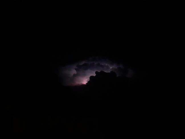 The strangest storm I have ever seen. I have never seen anything like it. We stood outside for 40 minutes watching the eerie silent storm. Absoutely breath taking.   'His lightening lights up the world; the Earth sees and trembles.' Psalm 97 vs 4