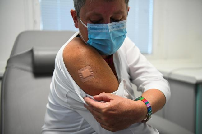 Kate Bingham, chair of the Government's Vaccine Task Force, with a plaster on her arm after starting her Novavax trial at the Royal Free Hospital, north London.