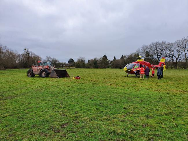 A dog walker has been airlifted to hospital after falling in a field. Picture: Leominster fire station