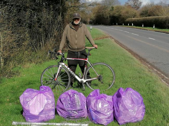 Thomas Collingwood with just a fraction of the bags he's filled as he clears litter from the verges on the A465 between Hereford and the Welsh border at Llangua
