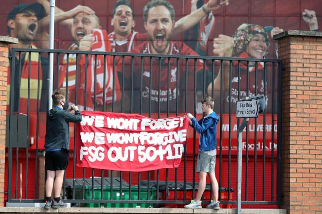 Liverpool fans protest against the clubs owners outside of Anfield