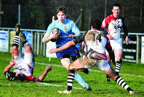 Malvern's Adam Dixon (centre) goes on a run during his side's 16-13 defeat to leaders Rugby Lions.