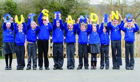 Pupils celebrate their Ofsted rating.