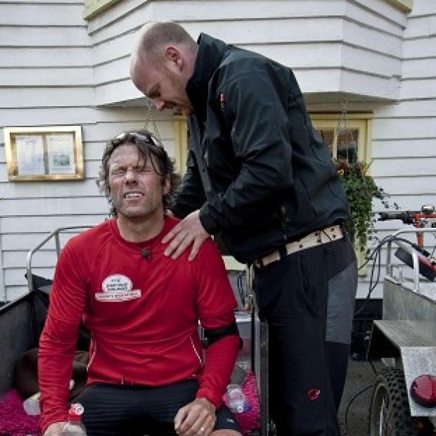 John Bishop receiving medical treatment during his second leg of his three marathons (Rhian Ap Gruffydd/PA)
