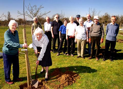 DIGGING IN: Claire Turner and Rita Armstrong plant a greengage tree