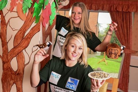 Feed the birds: Siobhan Drane, rear, of Bupa, Gabielle Layzell, of the RSPB.