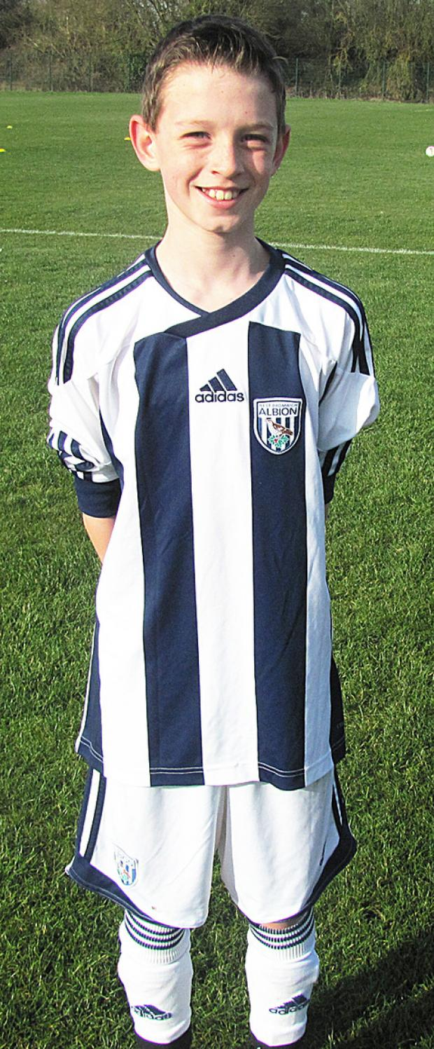 New West Bromwich Albion recuit Carrick Hill lines up.
