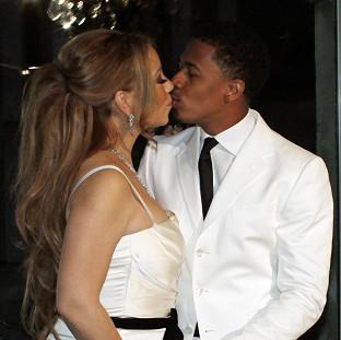 Mariah Carey kisses husband Nick Cannon in Paris (AP/Thibault Camus)