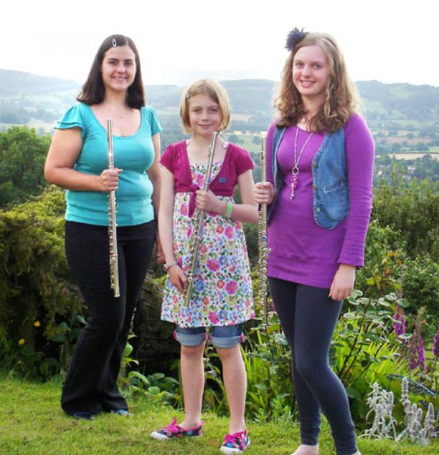 CHARITY: From left, Nicola Shorland, a local flute teacher with young Suzuki musicians Maddy Lee and Eden Haslam