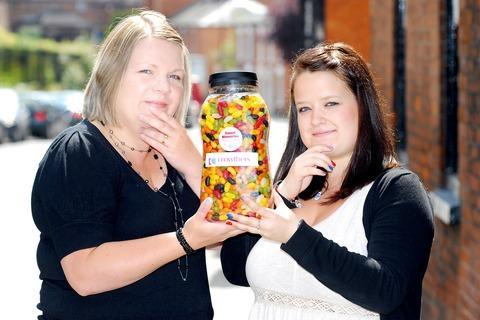 PUZZLER: Sally Cummings and Lorna Beggs, of Crowthers, with the jellybeans jar. 33109401.