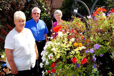 THEY'RE BLOOM WINNERS ALL: From left, Pam Cubberley, Don Cubberley and competition judge Maggie Williams. Picture taken by Paul Jackson. BUY THIS PHOTOGRAPH: worcesternews.co.uk/pictures/sales. 36125502