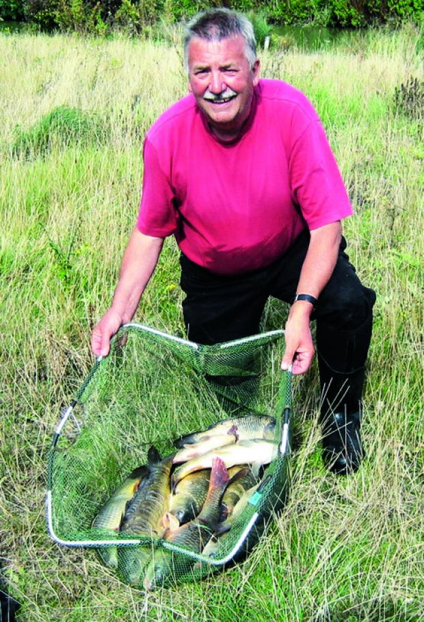 CATCH OF THE DAY: Dave Harris lines up with his haul after securing Malvern United Association's Club Cup.