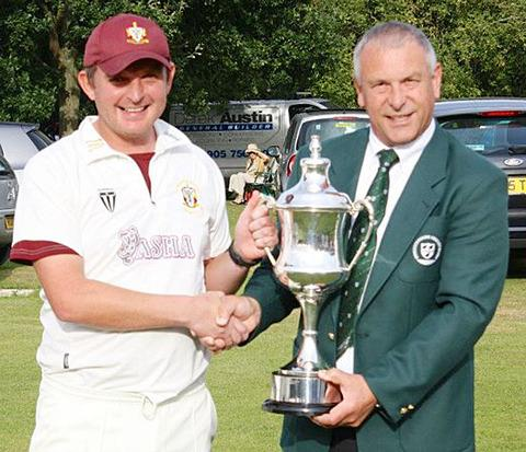 WE ARE CHAMPIONS: Worcester Nomads captain Ben Schiffmann receives the Worcestershire League's Division One trophy from chairman Peter Radburn.