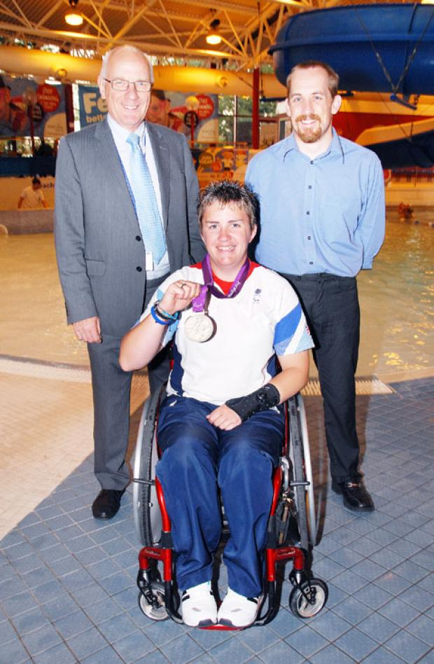 SUCCESS: Paralympics medallist Mel Clarke with Malvern Hills District Council leader David Hughes, left, and Splash general manager Ian Bonsall. 38312002