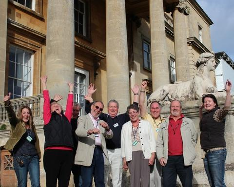 WE DID IT!: Staff and volunteers celebrate news of lottery funding outside Croome Court. Photograph by Richard Higgs.