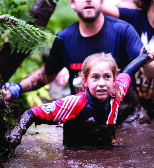 FUN IN THE MUD: The Downs, Malvern student Sofia Cupper was the only junior to take part in the Scottish round of the Mud Runner adventure trail series. Picture supplied by Alan Cupper.