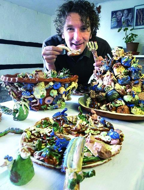 TUCKING IN: Jon Williams with the pottery items inspired by Roald Dahl's The Twits.