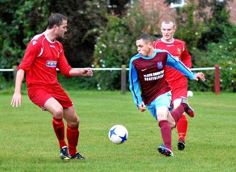 ON THE CHARGE: A Malvern Town player (right) goes on a run during his side's 2-1 victory over Willenhall Town. Picture: NICK TOOGOOD. 41153005
