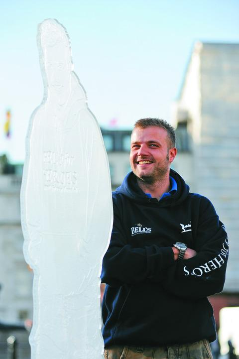 Matthew Wilson, of Much Birch, with his fundraising statue
