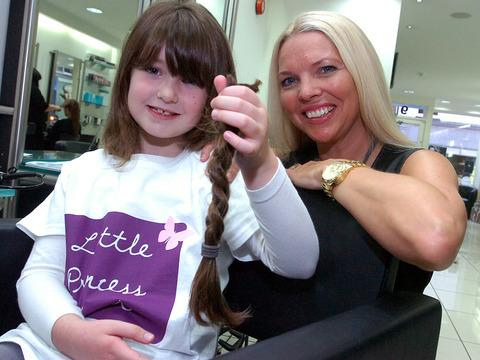Andrea Rolph of Toni and Guy cut Grace Whiting's hair, which will be donated to the Little Princess Trust. Picture by James Maggs.