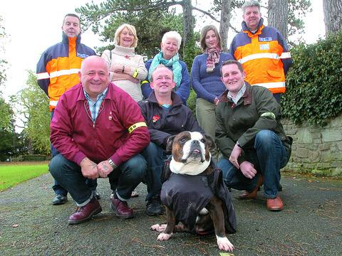 Baby the dog with Herefordshire dog warden Dave Goulding, Councillor Pauline Davies, Coun Felicity Norman, Anwen Atkinson, community protection officers Craig Sandman with (front) Darrel Maund, Coun Wayne Rosser, and Coun Andrew Atkinson