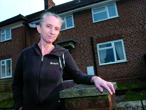 Sheila Cooke, who is set to have her housing benefit cut under the Government's new 'bedroom tax', outside her home in Hereford. Picture by James Maggs.