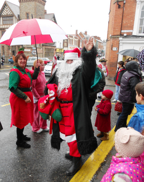 WET DAY: Father Christmas needed his brolly in Ledbury