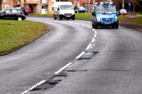 POTHOLES: In Tolladine Road. Worcestershire will receive an extra £3.2m funding for road repairs. 5112205104