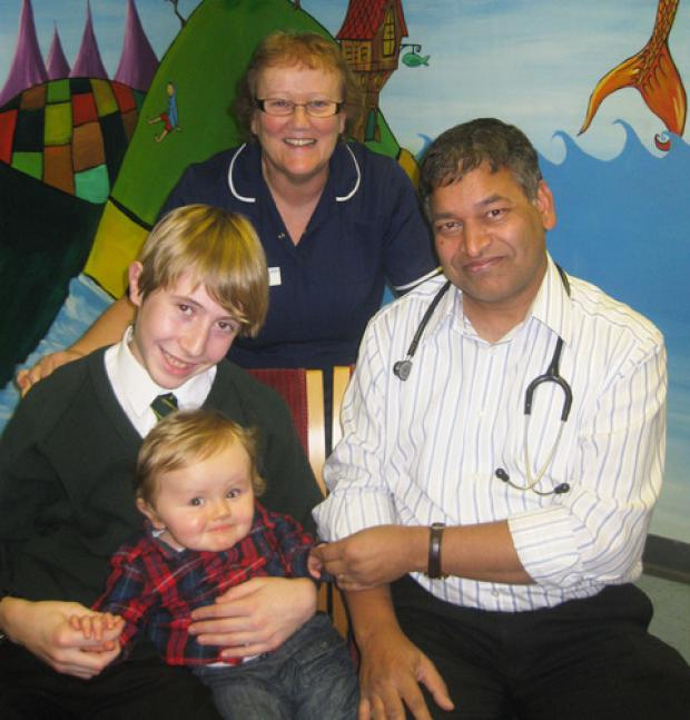THANK YOU FOR YOUR HARD WORK: Charlie Wood with baby brother Archie, Dr Shambhu Shah, consultant paediatrician and Carol Lamplutt, ward manager at Hereford Special Care Baby Unit.