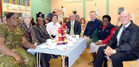 PARTY: From left, Salma Mrisho, Margaret Rutter, Peter Semwija, Simon Rowe, Tom Wells, Rev Mike Rogers, Evelyne Wombura, and Wayne Swanbrook