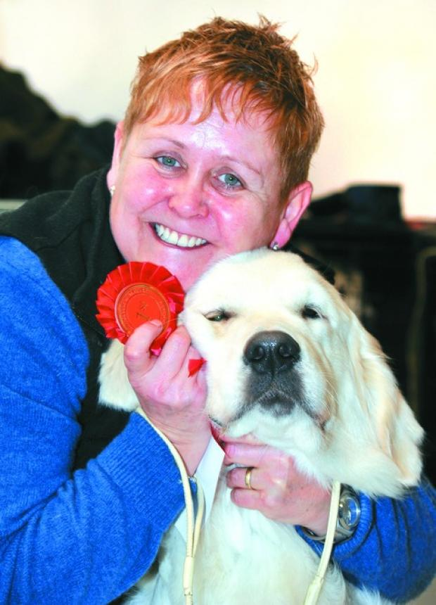 PUPPY LOVE: Paula Purnell with golden retriever Saffie