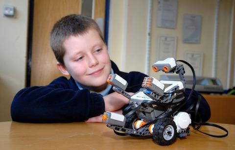 HI-TECH: Dan Disney, age 11, from John Masefield High, with a Mind Storm robot. 0313222401. Picture by Nick Toogood.
