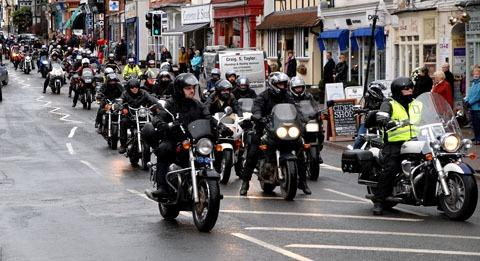 GUARD OF HONOUR: A total of 40 or more motorcyclists paid respects to shop owner and biking enthusiast Lee Vine.