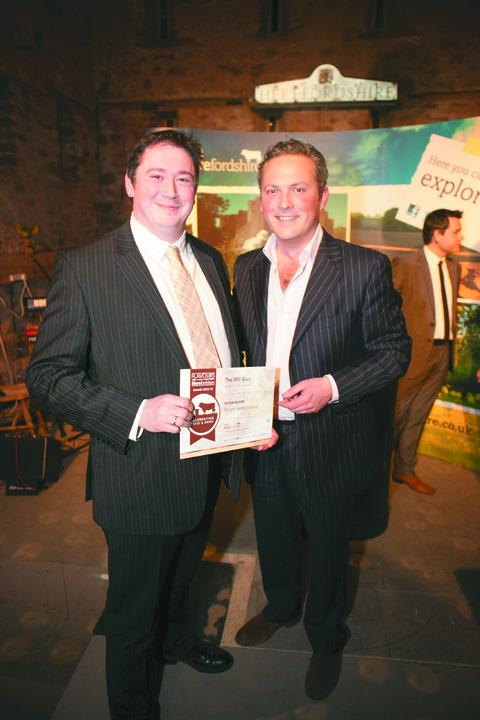 TV presenter Jules Hudson hands Richard Kaye of the Mill Race the gold award in the Gourmet Herefordshire category.