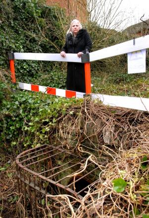 DISCOVERY: Councillor Annette Crowe has concerns about this ancient drain. 0713244701. Picture by Nick Toogood.