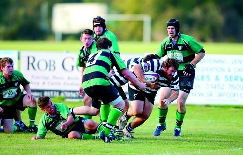 DOUBLE DELIGHT: Ledbury skipper Jock Welch (in possession) scored two tries in his side's 35-12 defeat to table-toppers Old Coventrians in Midlands Three West (South) on Saturday.