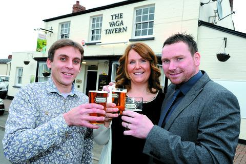 Vernon Amor, the managing director of Wye Valley Brewery, with landlords Becky and Ben Andrews